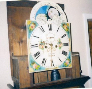 A close-up of the clock face, showing the beautifully coloured decoration. (Used with Permission).